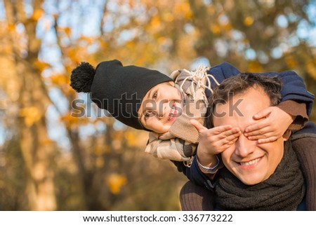 Happy family father and son walking in the park in autumn - stock photo