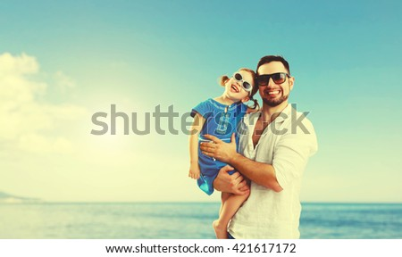 happy family father  day. dad and child daughter playing and having fun in in summer beach - stock photo