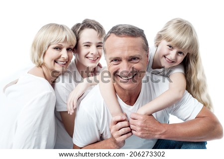 Happy family, father giving daughter a piggyback ride - stock photo