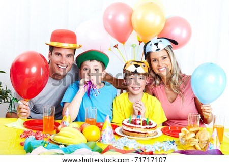 Happy family . Father, mother and children celebrating birthday at home - stock photo