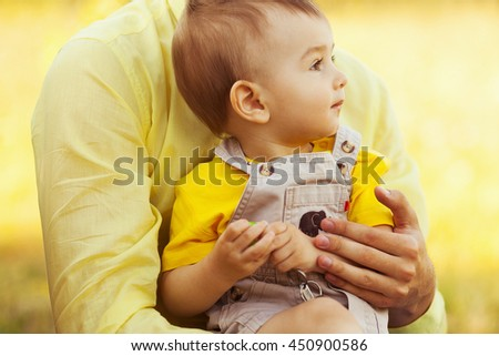 Happy family, friends forever concept. Father and little son in park. Dad holding baby. Sunny summer day. Close up. Outdoor shot