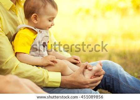 Happy family, friends forever concept. Father and little son in park. Dad holding baby. Sunny summer day. Close up. copy-space. Outdoor shot