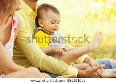 Happy family, friends forever concept. Father and little son playing in park. Dad holding baby. Sunny summer day. Close up. copy-space. Outdoor shot - stock photo