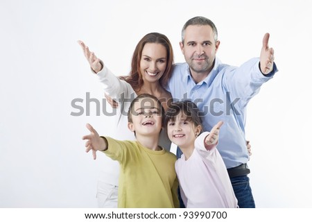 Happy family gesturing - Studio shot - stock photo