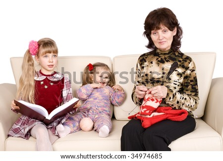Happy  family grandmother knits, child read book..Isolated.