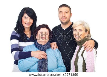 Happy family grandmother,mother and young couple standing in embrace together isolated on white background
