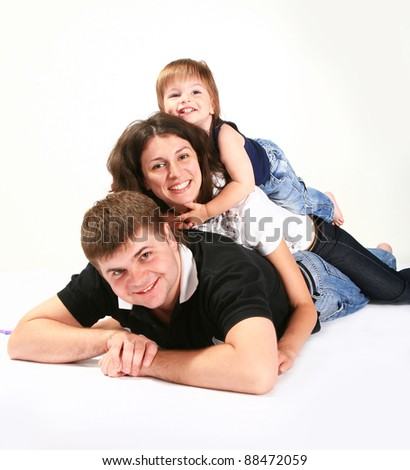 happy family happy together. Photographed in a studio against a plain background