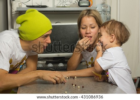 Happy Family Have a fun and Eating Breakfast (cereals) At Kitchen Table. - stock photo