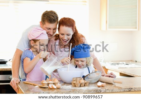 Happy family having a great time baking together - stock photo