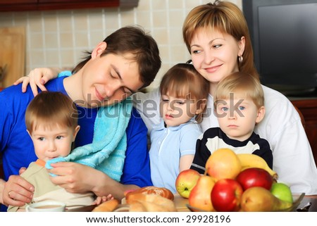 Happy family having a meal at home. - stock photo