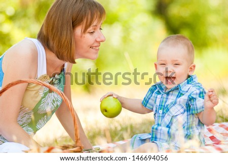Happy Family Having a Picnic In Summer Park - stock photo