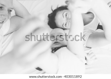 Happy family having a selfie. Photo in black and white  - stock photo