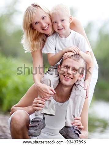 happy family  having a walk  in the park on a summer day - stock photo