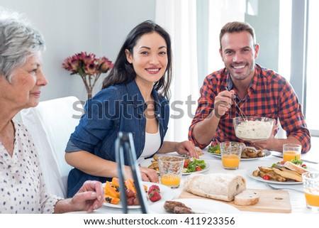 Happy family having breakfast in the morning - stock photo