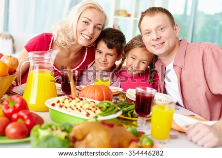 Happy family having dinner together at home - stock photo