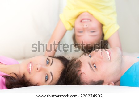 Happy family having fun at home - stock photo