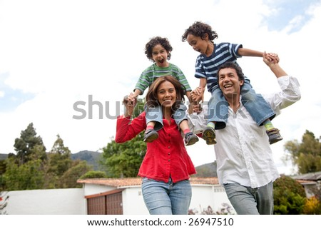 happy family having fun in front of their house