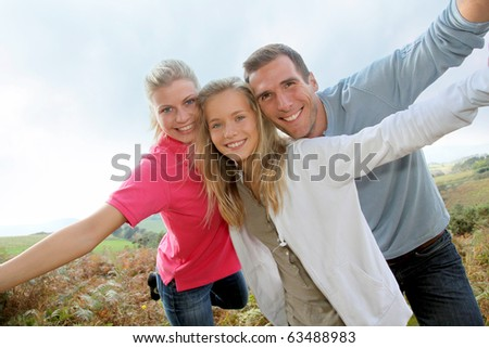Happy family having fun in the countryside - stock photo