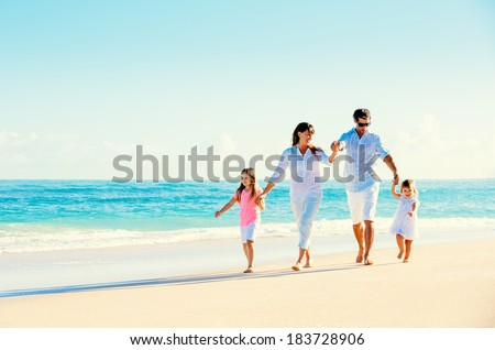 Happy Family Having Fun on Beautiful Sunny Beach - stock photo