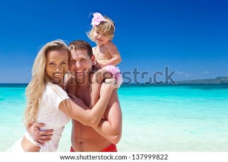 Happy family having fun on tropic vacation - stock photo