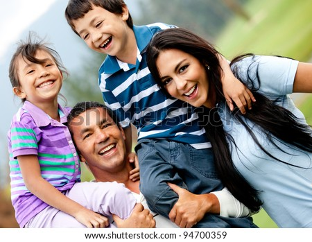 Happy family having fun outdoors and smiling - stock photo