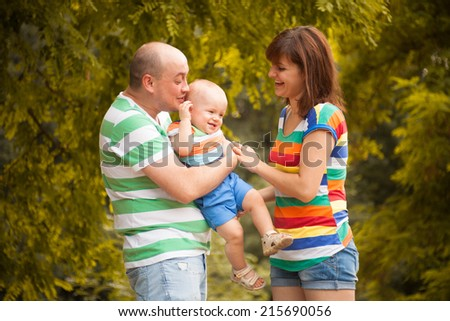 happy family having fun outdoors on a summer day