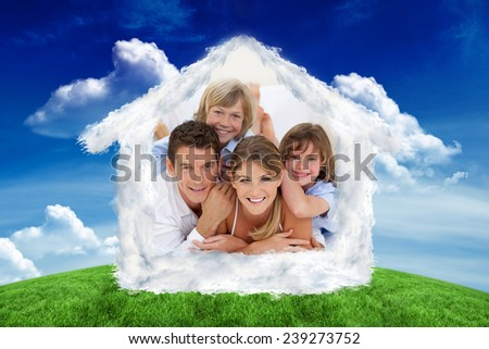 Happy family having fun together against green field under blue sky - stock photo