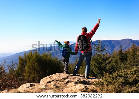happy family hiking in scenic mountains - stock photo
