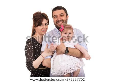 Happy family holding baby girl isolated on white background - stock photo