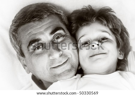 happy family home: father and - black and white photo - stock photo