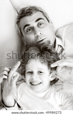 happy family home: father, mother and - black and white photo - stock photo