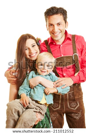 Happy family in bavaria smiling with child - stock photo