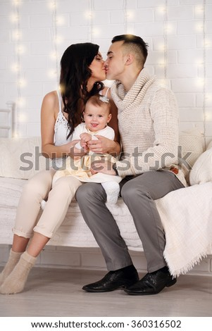 happy Family in bed playing and kissing - stock photo