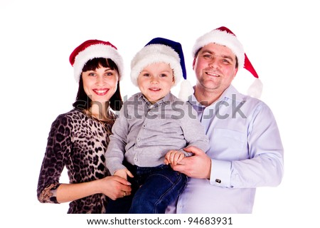 Happy family in Christmas hats isolated over white