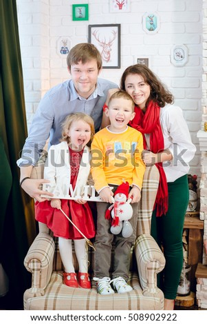 Happy family in Christmas interior