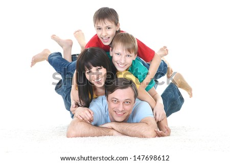 happy family in colored T-shirts on white background - stock photo