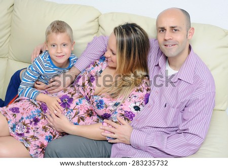 Happy family in expectation of a second child - stock photo