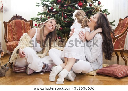 Happy family in front of Christmas tree,shallow depth of filed - stock photo