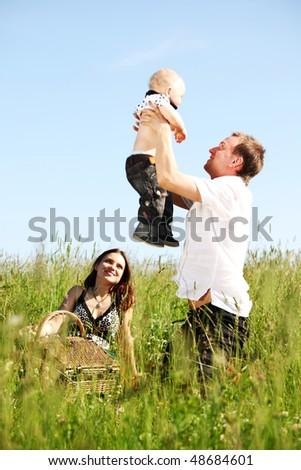 happy family in green grass - stock photo