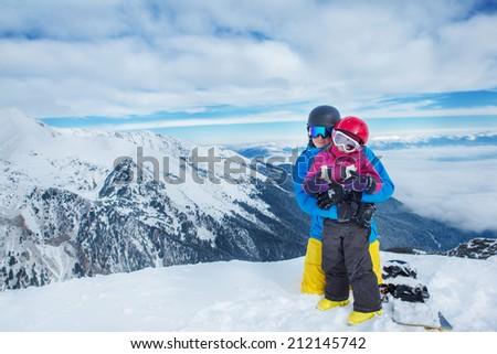 Happy family in ski equipment - stock photo