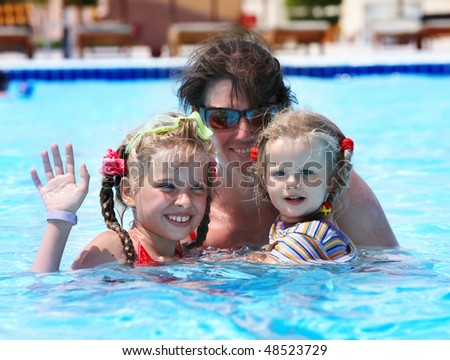 Happy family in swimming pool. Summer.