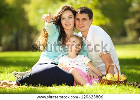 Happy family in the green garden - stock photo