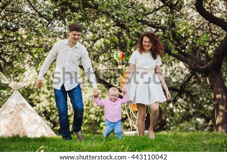 Happy family in the lap of the nature - stock photo