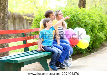 Happy family in the park - stock photo