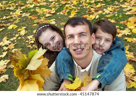 Happy family in the park on an autumn day - stock photo