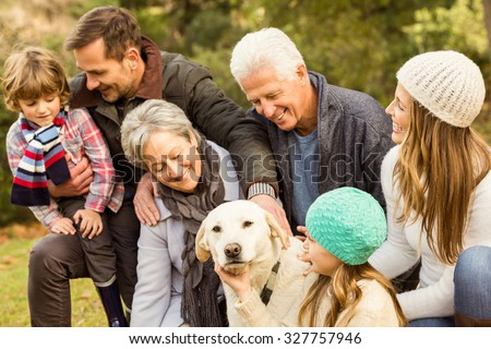 Happy family in the park together on an autumns day - stock photo
