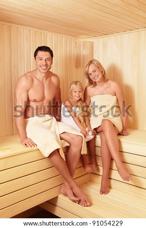 Happy family in the sauna - stock photo