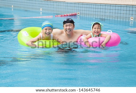 happy family in the swimming pool - stock photo