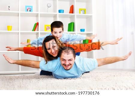 Happy family is enjoying in living room. - stock photo
