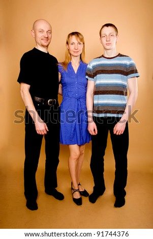 Happy family. Isolated on a beige - stock photo